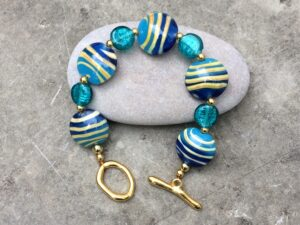 Ceramic striped coins bracelet by Xanthe  Breens